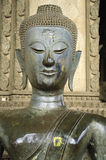Half body Ancient Buddhism statue in Laos Temple Stock Photos