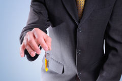Half-body commercial agent with keys in hand isolated Stock Photo