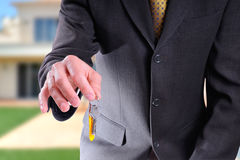 Half body commercial agent with keys in hand Royalty Free Stock Image