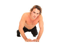 Half body naked young guy on the floor. Hsndsome guy on the floor  on a white background Stock Photo