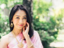 Half body portrait of Thai woman in Thai traditional custome. Half body portrait of Thai woman in Thai traditional custome stand in the garden royalty free stock photography