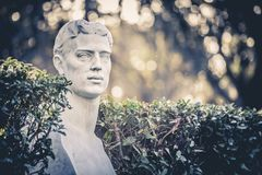 Half body statue in the Giardini Gardens del Pincio in Rome, Italy. Stock Photography