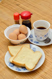 Half-boiled eggs with soy sauce and coffee and breads Stock Images