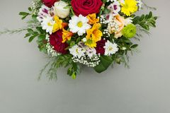 Half of a bouquet of flowers is isolated on a gray background royalty free stock photo