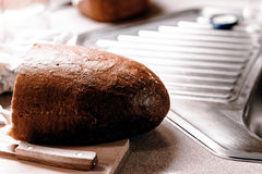 Half of bread in the kitchen Stock Image