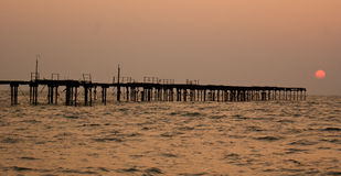 A half built bridge on sea. A half constructed bridge in a dilapidated condition on high sea stock photos