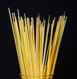 Half a bunch of spaghetti on a black background. Close up. royalty free stock image