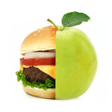 Half burger half apple concept Royalty Free Stock Images