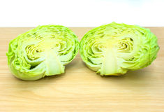 Half cabbage on wooden plate. Fresh half cabbage on wooden plate Stock Photography