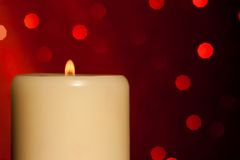 Half candle with flame on wood table, christmas theme Royalty Free Stock Photography