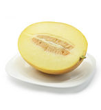 Half of cantaloupe melon on plate Royalty Free Stock Photo