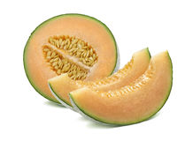 Half cantaloupe melon and slices isolated on white royalty free stock images