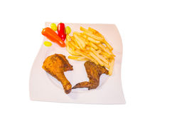 Half a chicken with chips Royalty Free Stock Images