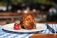 Half chicken in a traditional beer garden Royalty Free Stock Photos