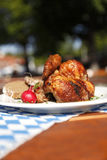 Half chicken in a traditional beer garden Stock Photography