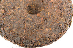 Half of chinese puer tea disc on white background Royalty Free Stock Images