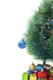 Half of the Christmas tree and gifts on a white Stock Photography