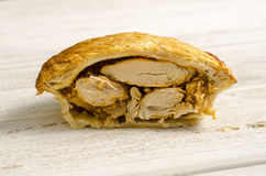 Half a Chunky Chicken Pie on White Wooden Background Royalty Free Stock Photo