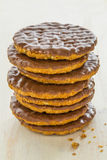 Half coated chocolate biscuits Stock Photos
