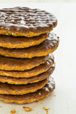 Half coated chocolate biscuits Royalty Free Stock Photo