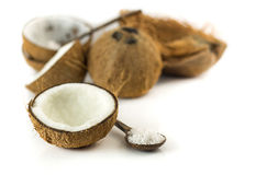 Half of coconut and grated on white background Stock Photo