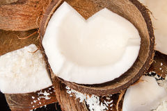 Half of coconut, pieces of coconut, coconut flakes Royalty Free Stock Photo