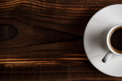 Coffee cup top view on wooden table background Royalty Free Stock Photos