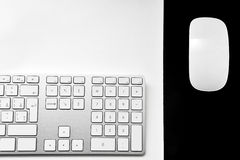Half computer keyboard and smart mouse. Half computer keyboard with mouse on mouse pad isolated on white /grey background Stock Images