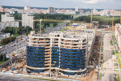 Half Constructed Building. A construction site in close proximity to Independence Square in Minsk. The entire construction site and the heavy equipment vehicle royalty free stock image