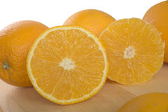 Half cross section of half peeled orange Stock Photography