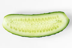 Half cucumber. Fresh ripe half cucumber cut on white background Stock Image