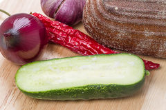 Half of cucumber with salt Royalty Free Stock Image