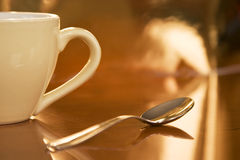 Half cup of coffee. And a spoon Royalty Free Stock Photo