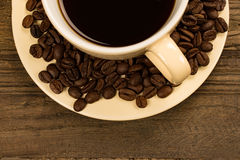 Cup of coffee with beans. Stock Photos