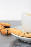 Half cup of coffee with cookies on the table Stock Image