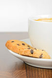 Half cup of coffee with cookies on table Royalty Free Stock Images
