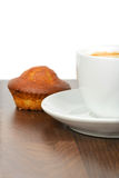 Half cup of coffee with cupcake on table Royalty Free Stock Photo
