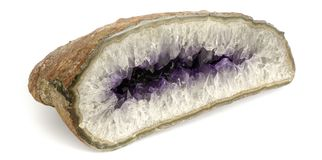 Half-cut amethyst stone perspective view isolated on white background. Amethyst geode close-up photo stock photos