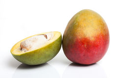 Half Cut And Whole Mango Royalty Free Stock Images