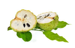 Half cut custard apple with leaves on white background Royalty Free Stock Photography