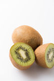 Half cut, fresh and organic kiwi fruit isolated on white Royalty Free Stock Photos