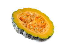 Half cut fresh pumpkin with seeds on white Royalty Free Stock Photo