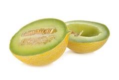 Half cut galia melon with seeds on white Stock Photo