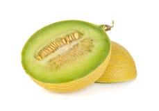 Half cut galia melon with seeds on white Stock Image