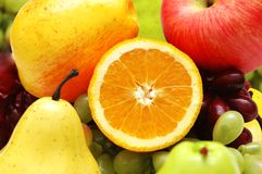 Half cut orange. And other colourful fruits Stock Images