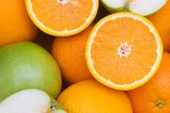Half cut oranges and apples Stock Image