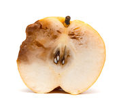 Half of a cut out rotten pear on white Stock Photography