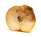 Half of a cut out rotten pear on white Royalty Free Stock Image