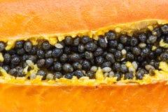 Half cut papaya fruits. Macro half cut papaya fruits. Surface layers of papaya Royalty Free Stock Images