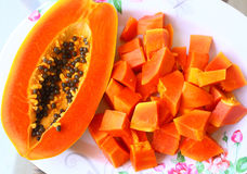 Half and cut papaya on the plate Stock Photo